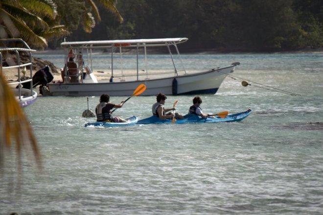 boys in kayaks
