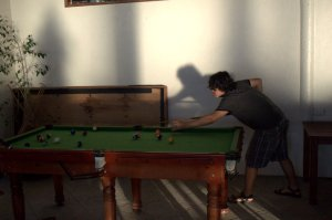 Matiu playing pool